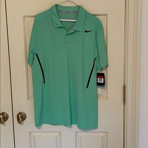 NWT Teal Nike polo. Nice color